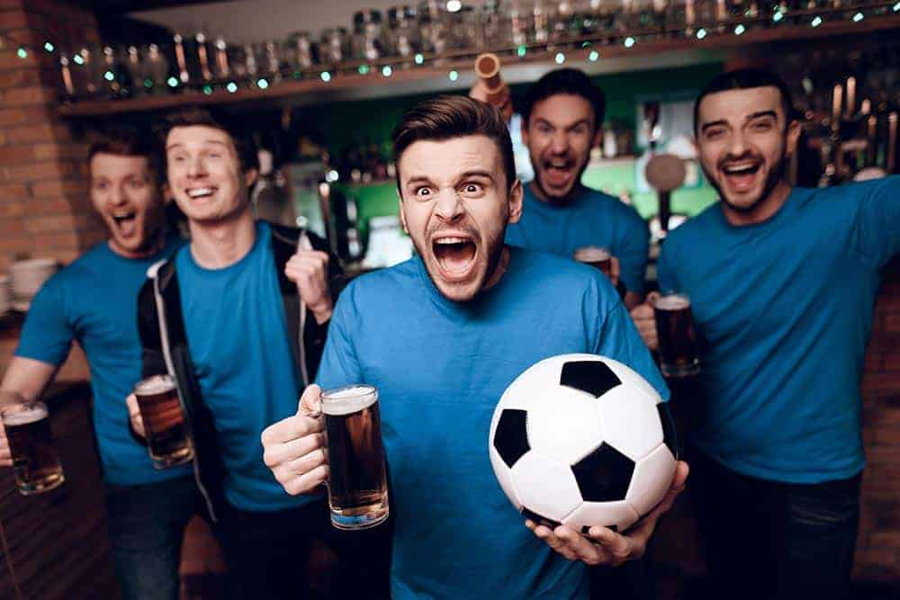 Watching the football with a couple of pints at the pub will save UK fans money